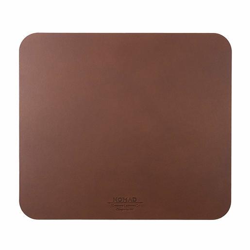 Коврик для мыши Nomad Leather Mousepad. Материал кожа натуральная. Размер 31,7x28 см. Цвет темно-коричневый.